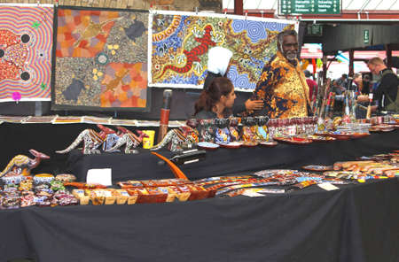 boomerangs: Melbourne, Victoria, Australia, april 2, 2013 An Aboriginal man sells Aboriginal art at the historical Queen Victoria Market in Melbourne. This market is operating since 1878  Editorial