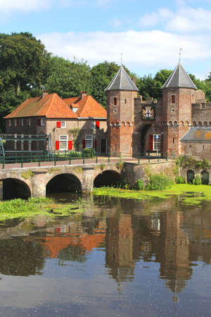 eem: Medieval town wall along the Eem river in Amersfoort  The city of Amersfoort is a tourist destination about 40 kilimeters from Amsterdam in the Netherlands
