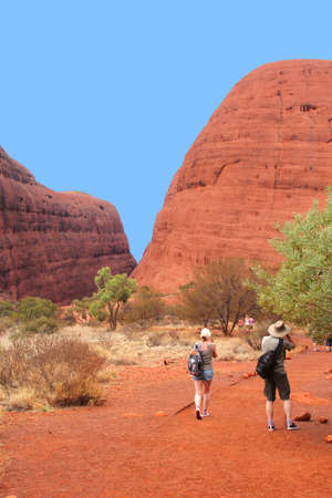 Uluru Kata Tjuta National Park, Northern territory, Australia, march 25, 2013 Tourists are hiking along the rocks of the Olgas Kata Tjuta