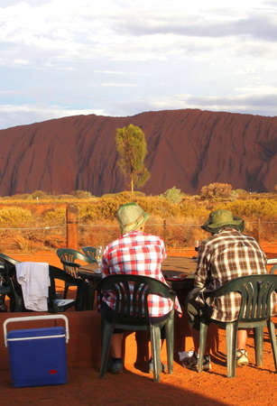 picknick: Ayers Rock, Northern Territory, Australia, march 25, 2013 Tourists are enjoying the sunset at Uluru Ayers Rock during a picknick with a glass of wine
