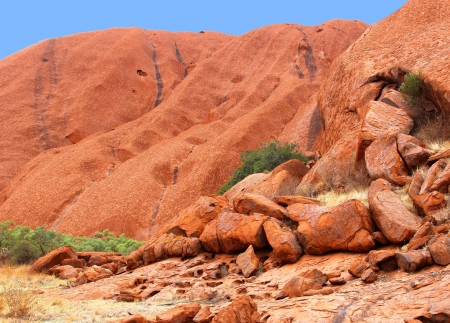 Part of the Ayers Rock mountain in the stone desert in the Australian outback  photo