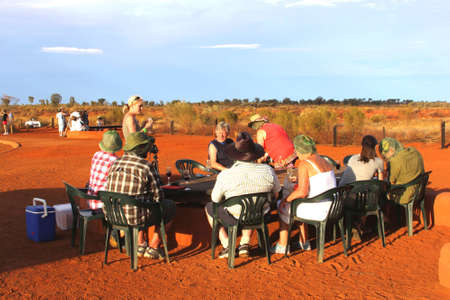 Ayers Rock, Northern Territory, Australia, march 25, 2013 Dinner at sunset in the Uluru Kata Tjuta National Park in the red desert of Australia  Stock Photo - 21120866