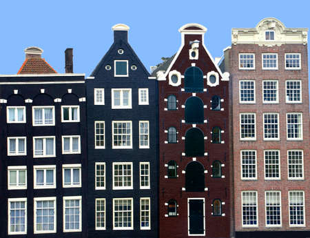 klompen: Dutch medieval canal houses in Amsterdam in close up