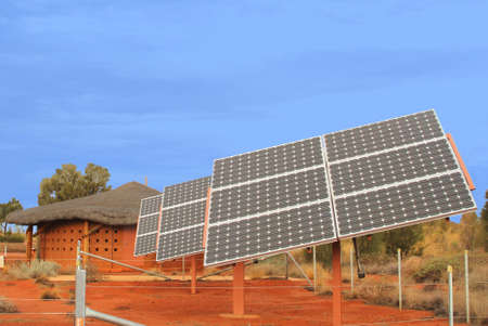 Solar panels in the red desert photo