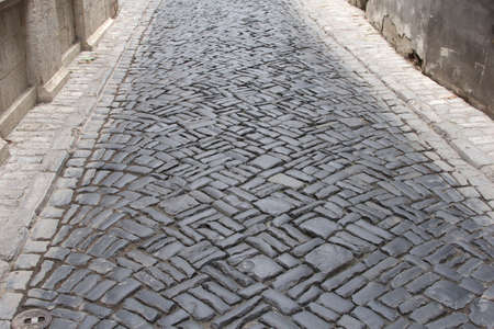Background a street with medieval vintage cobblestones photo