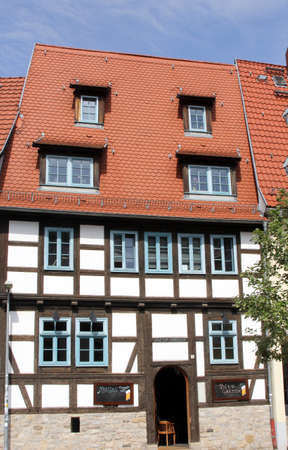 biergarten: Erfurt, Thuringen, Germany, august 7, 2013 Ancient colorful half-timbered beer garden in the historical city centre of Erfurt in Thuringia