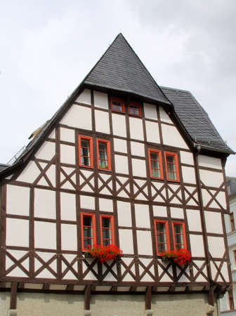 fachwerk: Erfurt, Thuringen, Germany, august 9, 2013 Ancient colorful fachwerk house at the Domplatz in the historical city centre of Erfurt