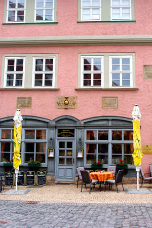 biergarten: Gotha, Thuringen, Germany, august 7, 2013 A cafe bar restaurant with terrace in the historical city centre of Gotha in Thuringian forest in Germany  Editorial