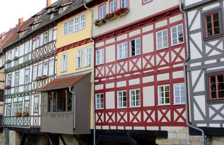 fachwerk: Erfurt, Thuringen, Germany, august 7, 2013 Ancient fachwerk houses at the Merchants Bridge Kraemerbruecke  in the historical city centre of Erfurt in Thuringia