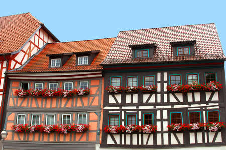 fachwerk: Thuringian Forest, Germany, august 7, 2013 Colorful fachwerk houses with blooming geraniums in Thuringia