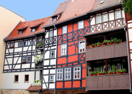 fachwerk: Erfurt, Thuringen, Germany, august 7, 2013 Ancient fachwerk houses at the Merchants Bridge in the historical city centre of Erfurt in Thuringia;  the merchants bridge is the longest bridge of the world which is built with houses