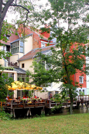biergarten: Erfurt, Thuringen, Germany, august 7, 2013 Terrace along the Breitstrom river in the historical city centre of Erfurt in Thuringia Editorial