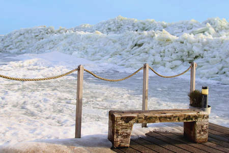 marken: Wooden couch near drifting ice in Marken along the IJsselmeer Stock Photo