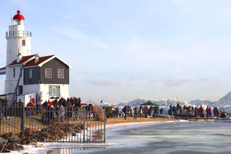 Marken, Netherlands, januari 28, 2013 People are enjoying the drifting at the lighthouse Horse of Marken near Amsterdam