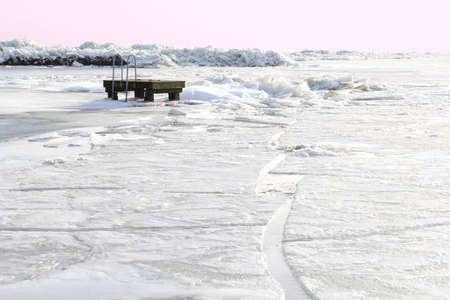 Drifting ice and a landing-stage in a frozen Markermeer in the Netherlands photo
