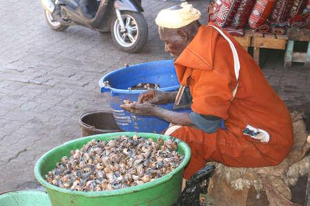 travelling salesman: Marrakech, Morocco, june 8, 2013 Berber is selling snails at Djemaa el Fna in Marrakech Editorial