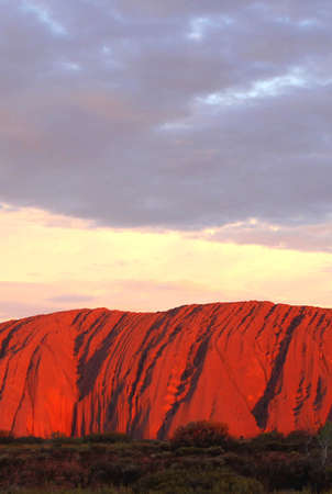 tjuta: Uluru Kata Tjuta National Park, Northern Territory, Australia, march 25, 2013 Landscape with a colorful sunset at the Uluru Ayers Rock in Australia