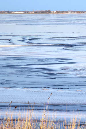 marken: Blue colors of a frozen lake IJsselmeer near Marken in the Netherlands Stock Photo