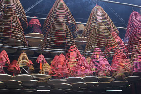 Colorful decorations of burning incense in a Chinese temple photo