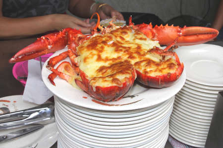 lantau: Deluxe fresh lobster with cheese is served at a buffet in a restaurant Stock Photo