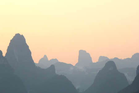 Sunset in the karst mountains near the village Xingping; this landscape is famous and is printed on the banknotes of 20 Yuan photo