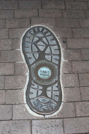 globetrotter: Footprint of a globe-trotter who is traveling to Brasilia in Brazil