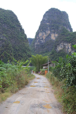Dirt road between the karst mountains near Yangshuo in China photo