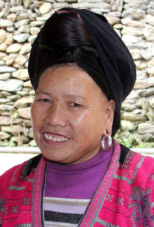 Dazhai, Longji, province Guangxi, China, november 19, 2013  Portrait of a woman of the Yao hill tribe in traditional costume