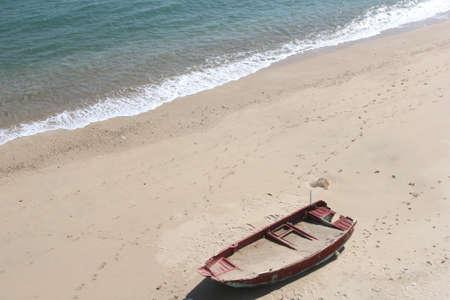 discover: Boat at a desolate white beach at Cheung Chau island in Hong Kong