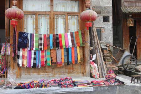 Souvenir shop with hand woven shawls in Dahzhai in Longsheng China Stock Photo