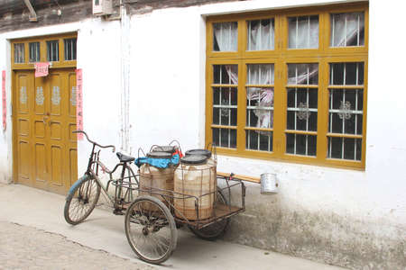 Vintage bike with trailer in the old town of Daxu near Guilin in China photo