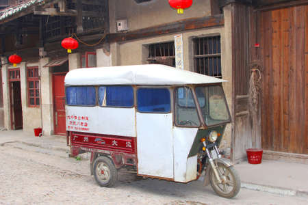 Daxu, provinve Guangxi, China An oldtimer tuk tuk taxi in the old town Daxu near Guilin in China