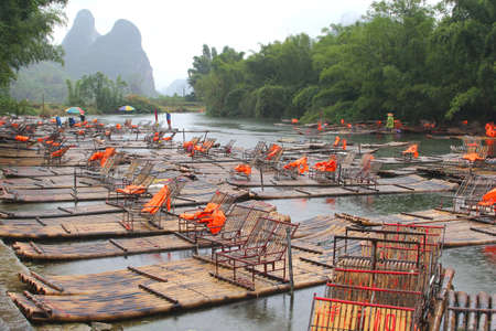 Bamboo rafts in the river between Xingping and Yangshuo in China Stock Photo