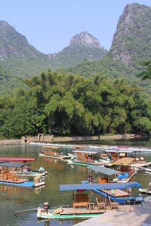 Rafting boats in the karst mountains between Yangshuo and Guilin in China