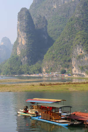 Rafting boats in the karst mountains between Yangshuo and Guilin in China photo