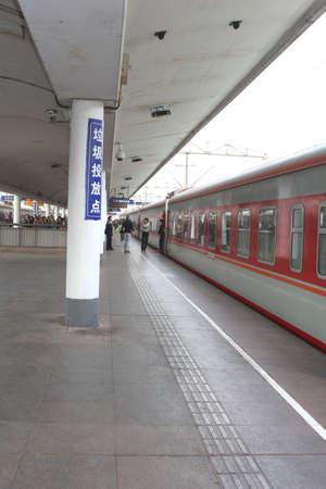 Guangzhou, province Guangdong, China, november 22, 2013 A long distance train in waiting at the railway station of Guangzhou