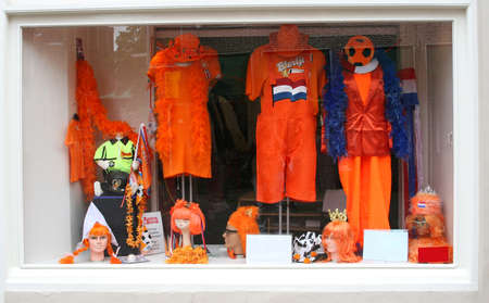 Amsterdam, Netherlands A shop with orange stuff, trousers, crowns and shirts for Kingsday and World Cup football 2014