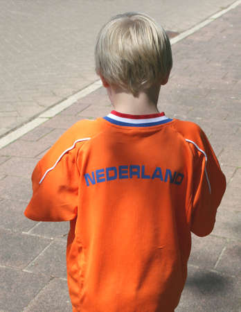 Dutch boy in orange for Kingsday and World Cup football 2014 photo