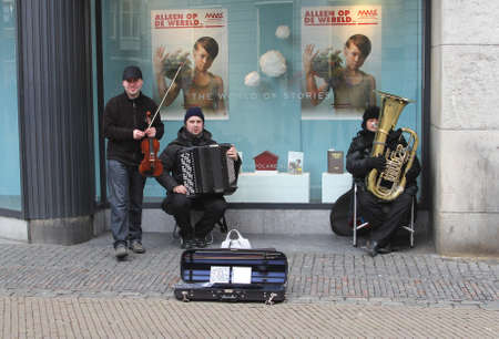 violin making: Utrecht, Netherlands, february 2014 Romany musicians are playing gypsy music in the city centre of Utrecht  Editorial