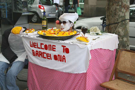 Barcelona, Spain, 2014 Street artist is entertaining at Las Ramblas  to welcome tourists to Barcelona  Stock Photo - 26062199