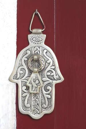 doorknocker: Door knocker Hand of Fatimah at a vintage door