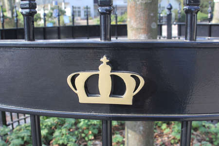honouring: Lage Vuursche, Netherlands, March 2014 A golden crown at a fence to honour King Willem-Alexander  Editorial