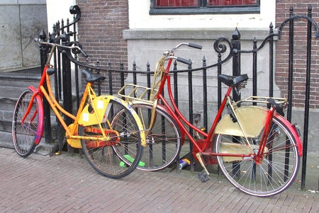 Colorful painted retro students bikes photo