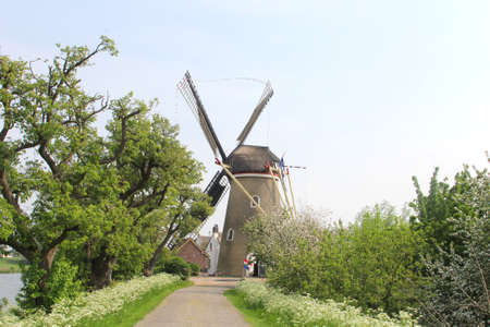 singular architecture: Beesd, Geldermalsen, Netherlands, april 2014 Characteristic landscape with traditional Dutch corn windmill, called The Freedom