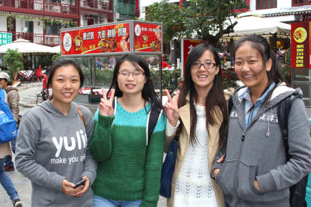 Yangshuo, China Happy students in West Street in the city centre if Yangshuo