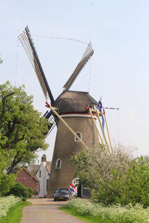 characteristic: Characteristic Dutch landscape with corn windmill the Freedom in Beesd, Betuwe, Holland Stock Photo