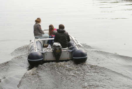 plassen: Loosdrecht, Netherlands, may 2014 Young people navigate in a motor-boat on the lakes of Loosdrecht, Holland