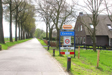 typically dutch: Eemnes, Netherlands, may 2014 Village scene and entrance of the village Eemnes in the Eempolder Editorial
