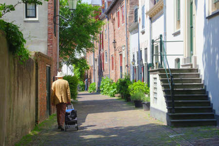 Amersfoort, Netherlands, may 2014 Man is walking in the Muurhuizen  Wall-houses , an ancient street in the old town of Amersfoort