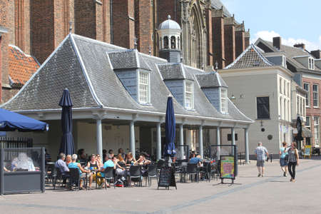 Amersfoort, Netherlands, may 2014 People enjoy at a sunny terrace at the Hof in the medieval town of Amersfoort